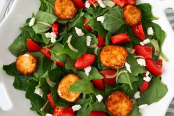 tomato spinach salad with fried goat cheese