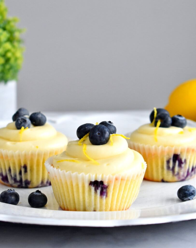 Lemon Blueberry Cupcakes frosted with cream cheese icing