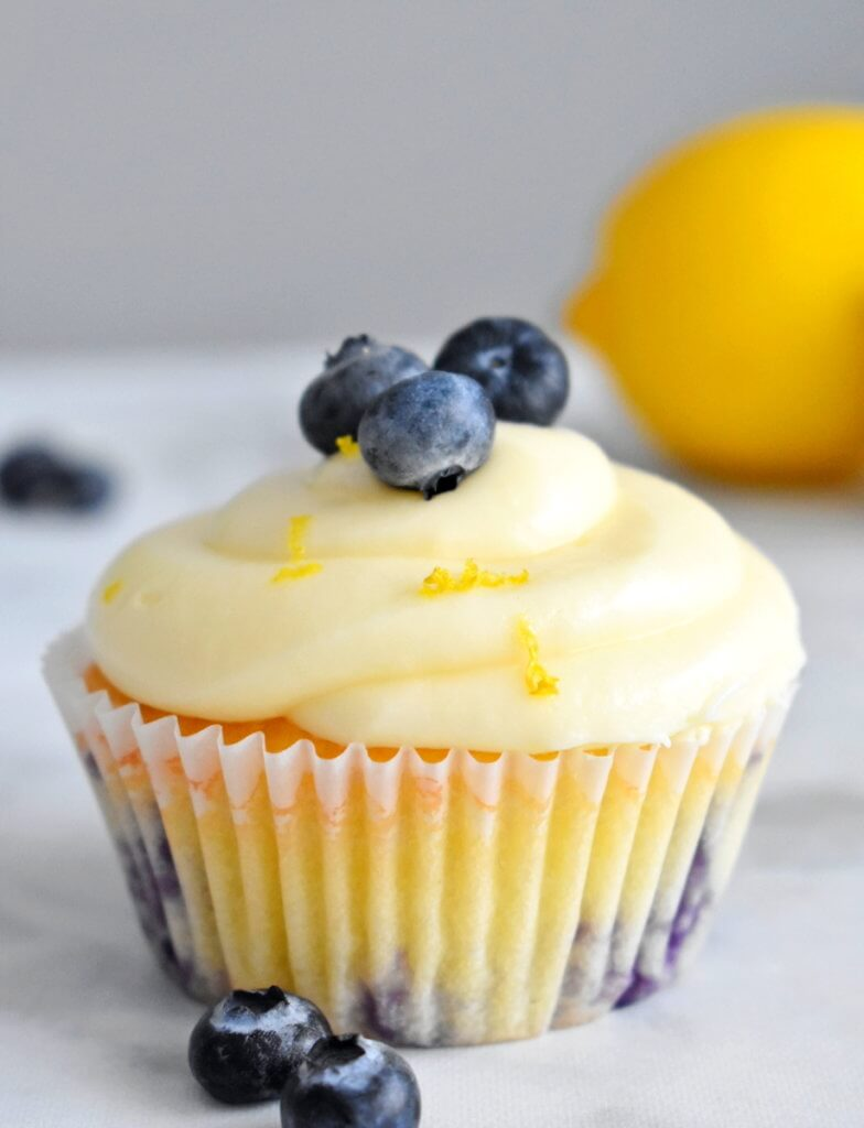 a lemon blueberry cupcake topped with fresh berries