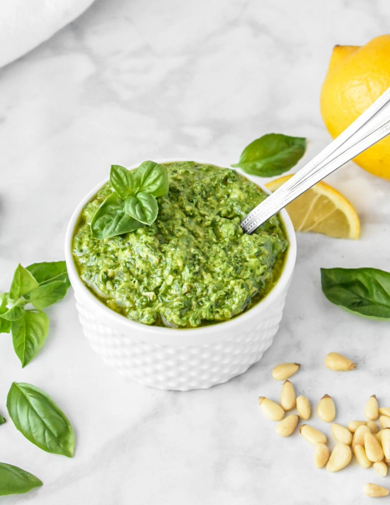 basil pesto in a bowl topped with fresh basil