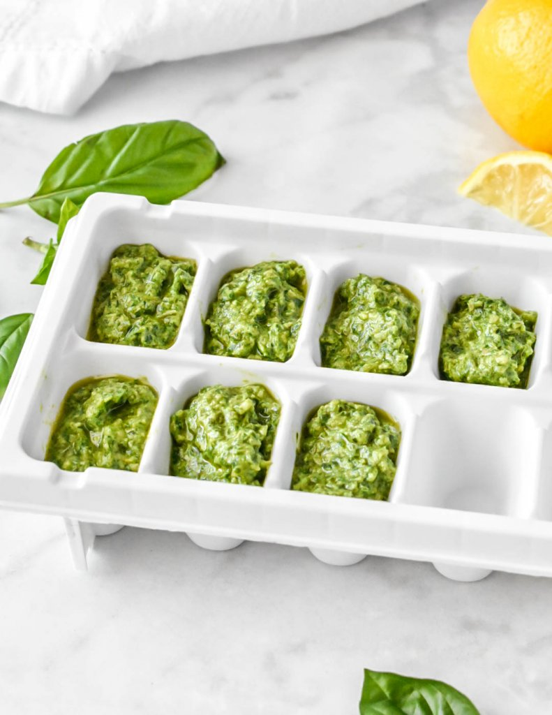 basil pesto in an ice cube tray