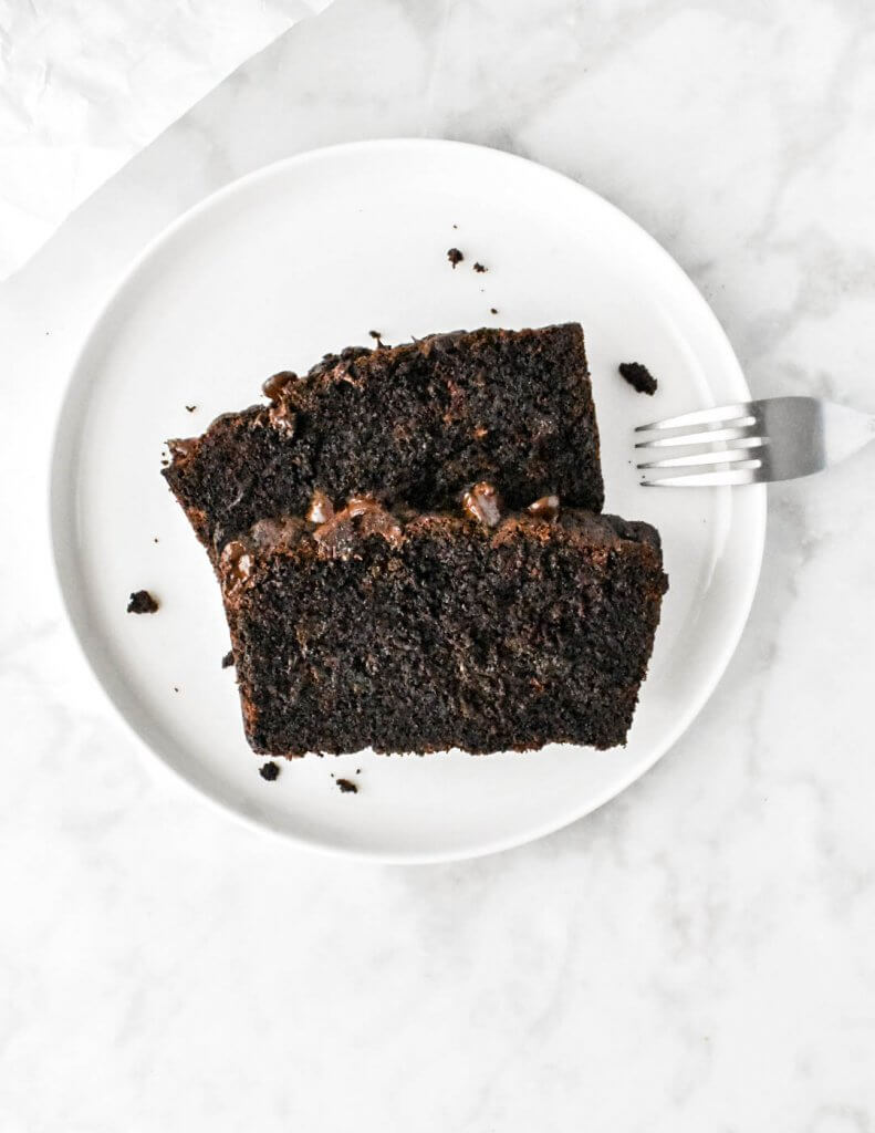 2 slices of chocolate zucchini bread on a white plate