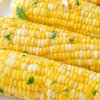 roasted corn on the cob sprinkled with fresh parsley