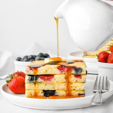 Stack of sheet pan pancakes with syrup poured on