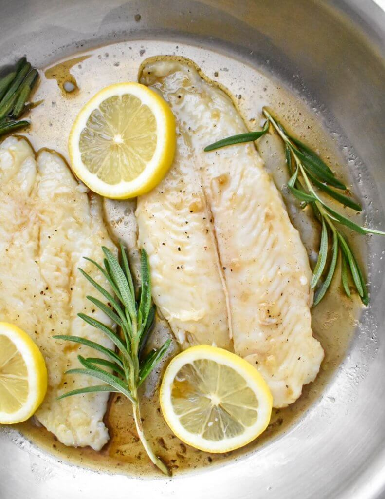 Basa fish fillets covered in brown butter sauce