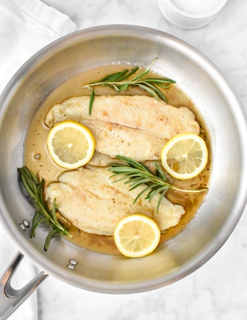pan of basa fish fillets in a brown butter sauce
