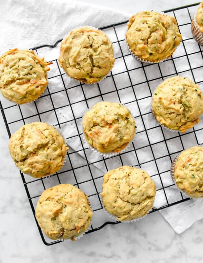 carrot zucchini muffins on a cooling rack