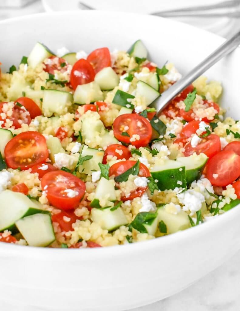 Mediterranean Couscous Salad in a white bowl