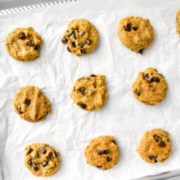 baked pumpkin chocolate chip cookies on a sheet pan