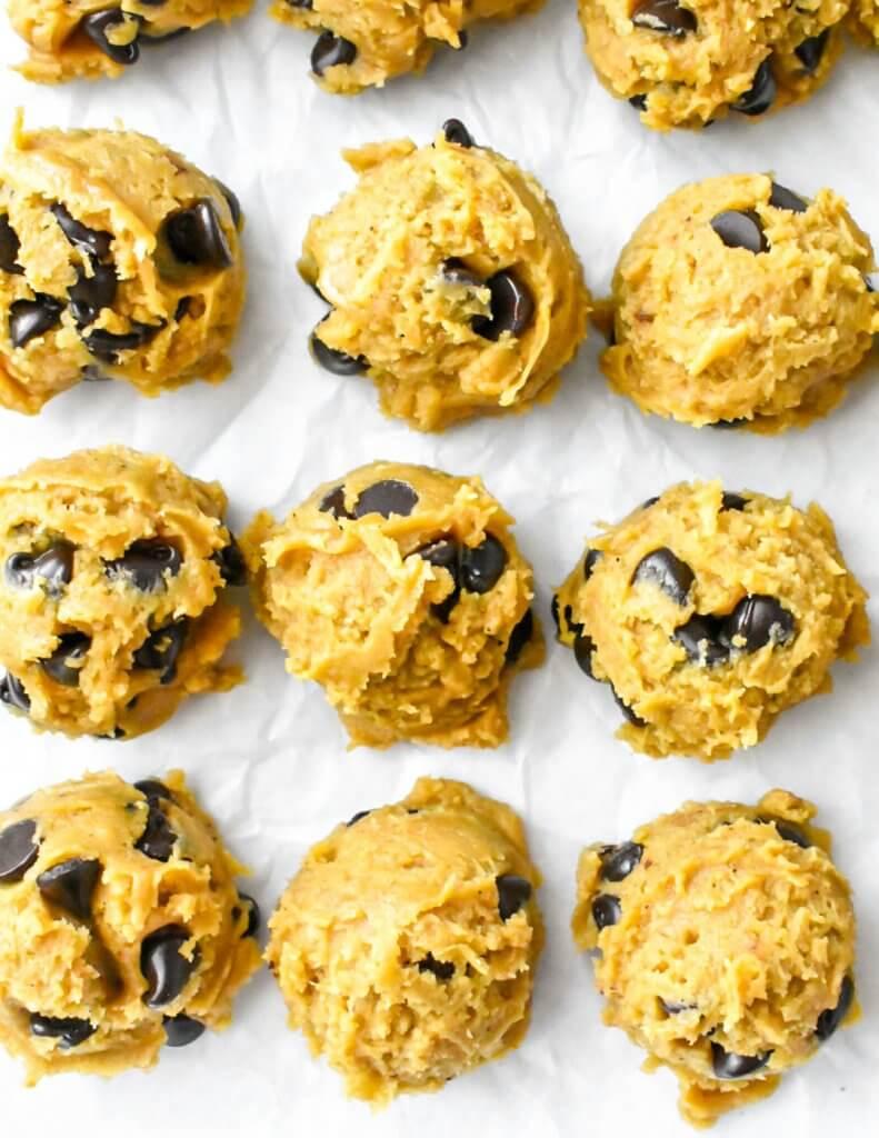unbaked pumpkin chocolate chip cookies on a sheet pan