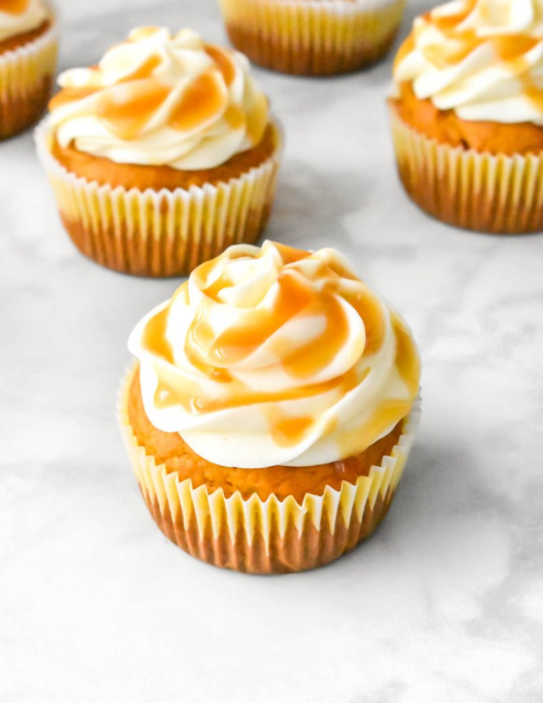 Pumpkin Cupcake with Cream Cheese Frosting and caramel drizzle
