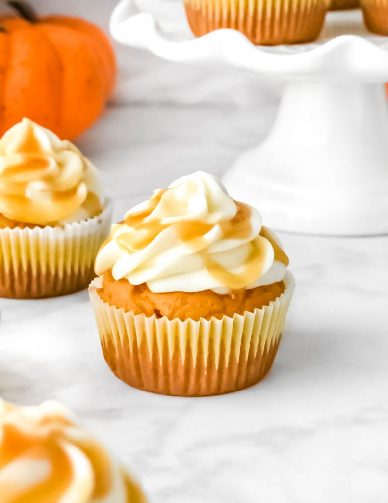 Pumpkin Cupcakes with Cream Cheese Frosting and a caramel drizzle