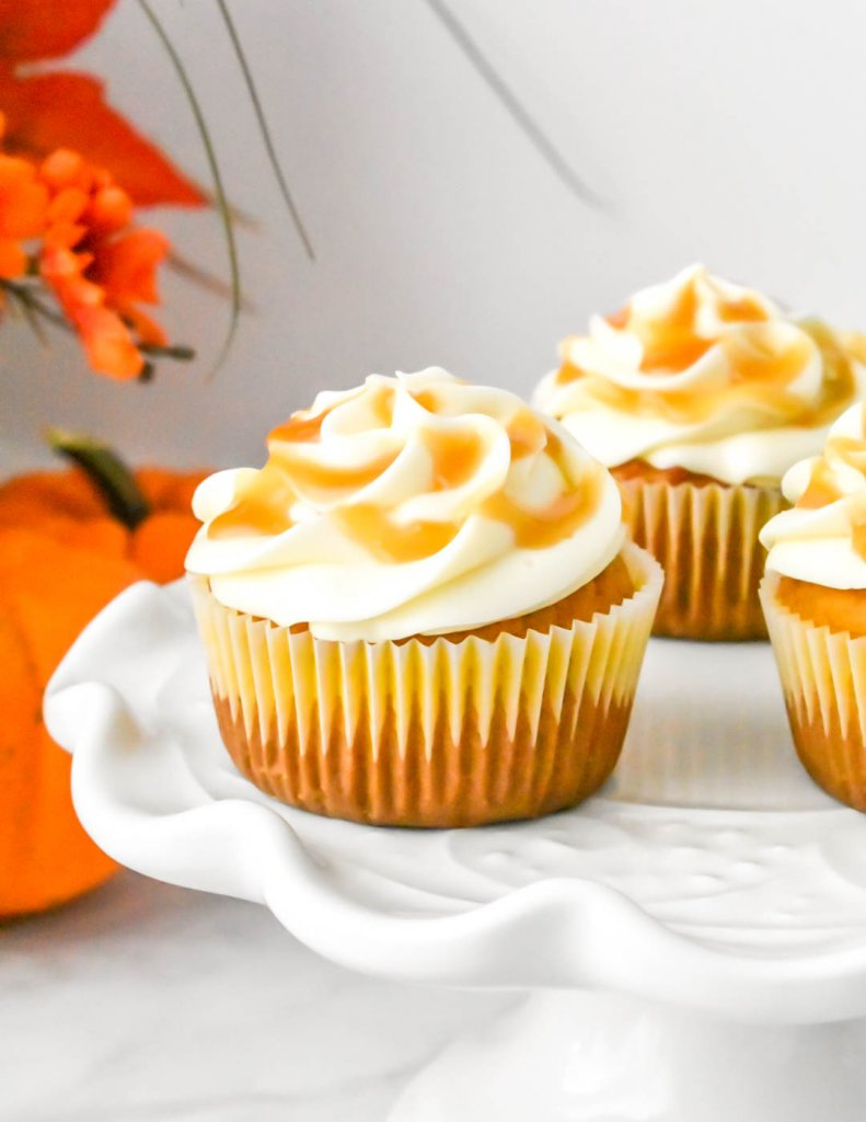 Pumpkin Cupcakes with Cream Cheese Frosting on a platter