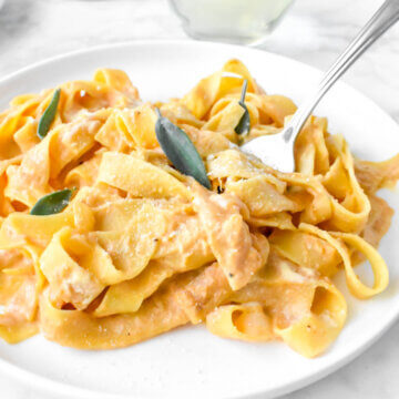 plate of Pumpkin Fettucine Alfredo topped with sage