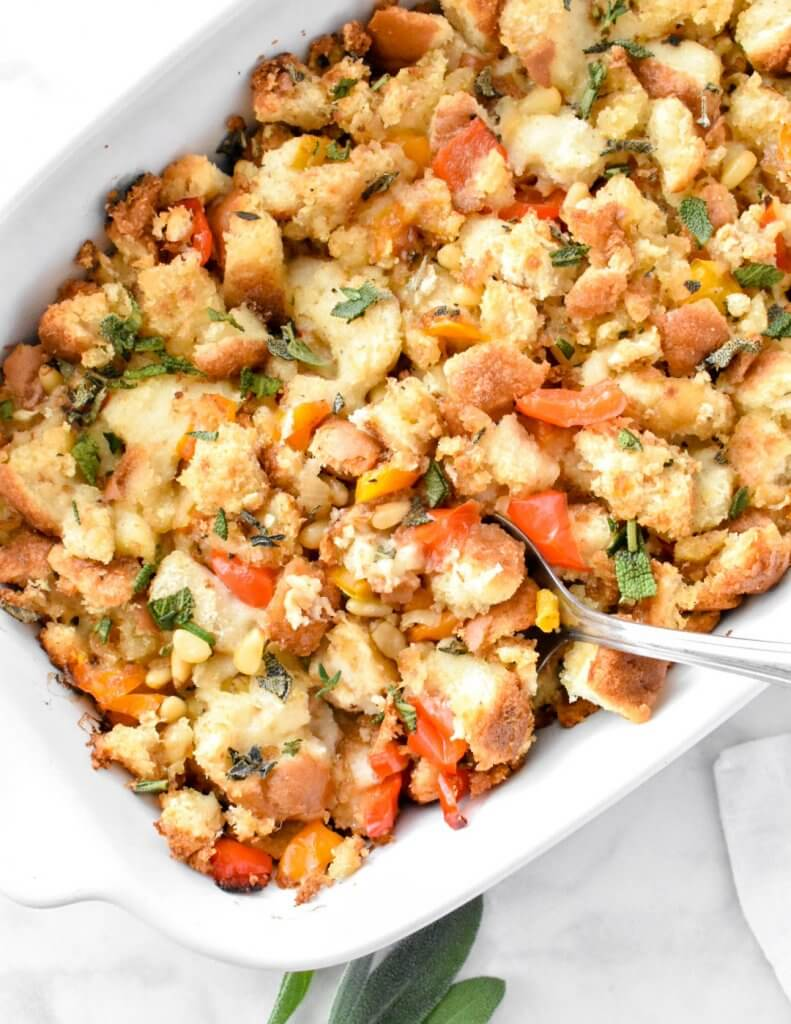 Platter of classic bread stuffing with peppers and fresh herbs